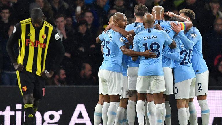 Manchester City players celebrate Leroy Sane's opener