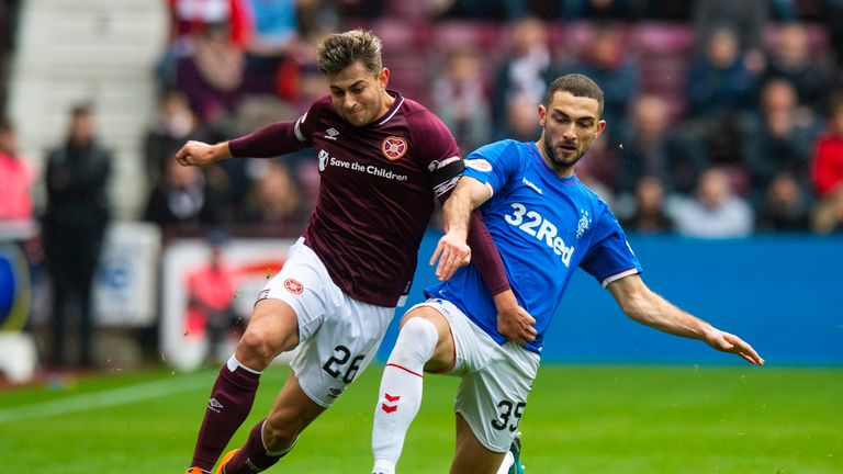 Hearts' Marcus Godinho and Rangers' Eros Grezda in action