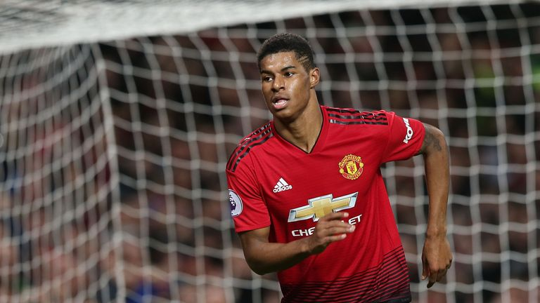 Marcus Rashford turns away in celebration after scoring Manchester United's third goal