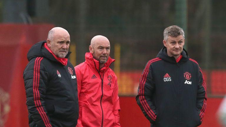 Mark Dempsey observes training alongside Ole Gunnar Solskjaer United's at Aon Training Complex