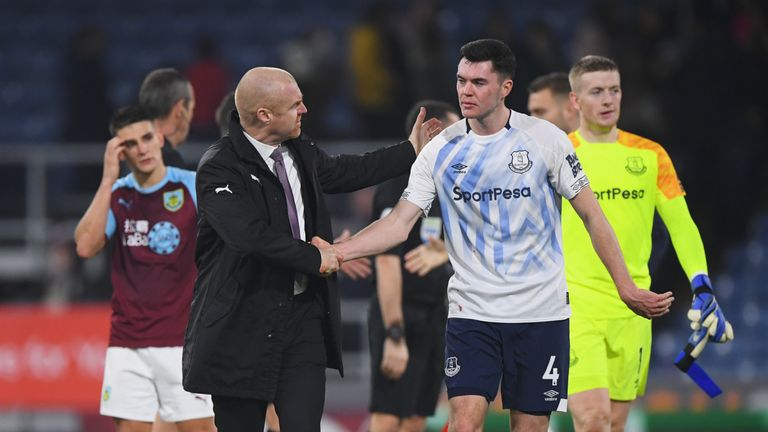 Dyche shakes the hand of former Burnley defender Michael Keane