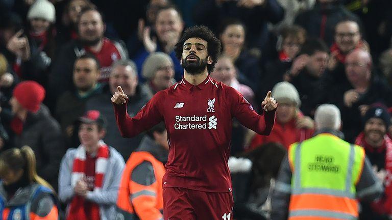 Mo Salah celebrates Liverpool's opening goal against Napoli