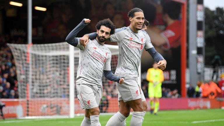 Mohamed Salah celebrates his second goal with Virgil van Dijk