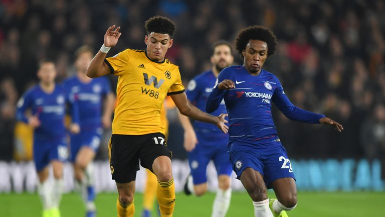 Morgan Gibbs-White (L) attempts to get away from Willian
