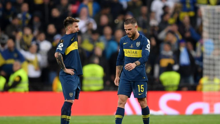 Nahitan Nandez (R) is left dejected following Boca's defeat