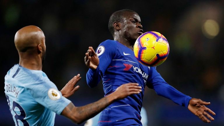 N'Golo Kante chests the ball under pressure from Fabian Delph