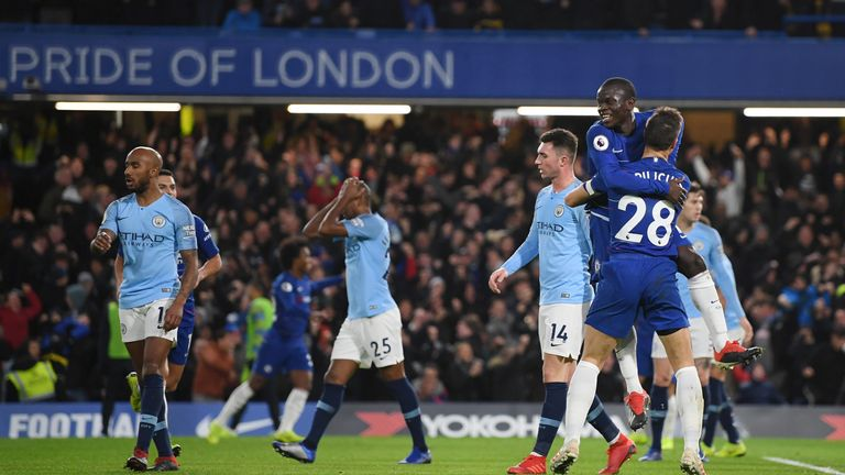N'golo Kante of Chelsea celebrates after scoring his team's first goal with Cesar Azpilicueta of Chelsea during the Premier League match between Chelsea FC and Manchester City at Stamford Bridge on December 8, 2018 in London, United Kingdom
