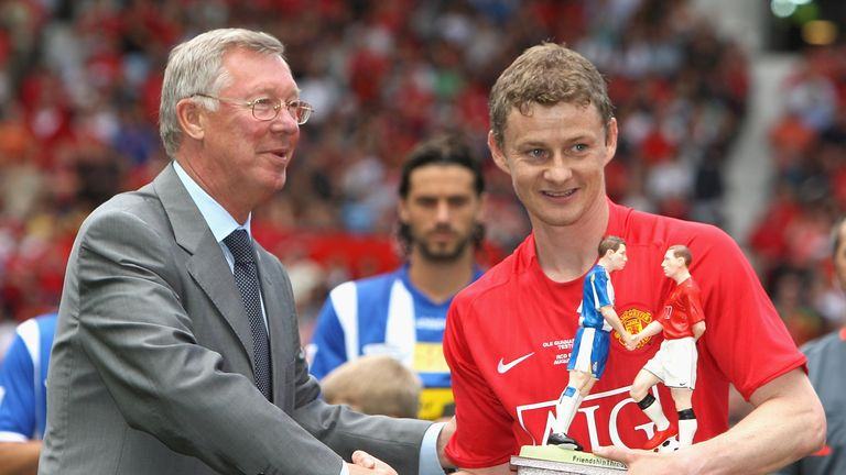 Manchester United manager Sir Alex Ferguson and Ole Gunnar Solskjaer shake hands prior to his testimonial friendly match between Manchester United and Espanyol at Old Trafford in 2008.