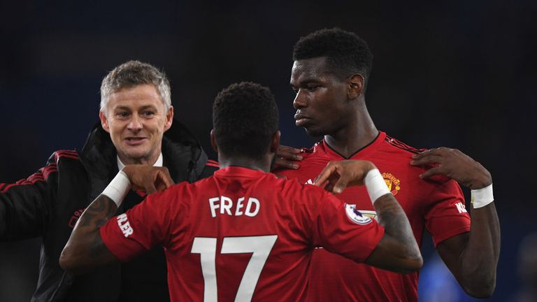 Ole Gunnar Solskjaer, Interim Manager of Manchester United celebrates with Fred and Paul Pogba after the Premier League match between Cardiff City and Manchester United at Cardiff City Stadium on December 22, 2018 in Cardiff, United Kingdom