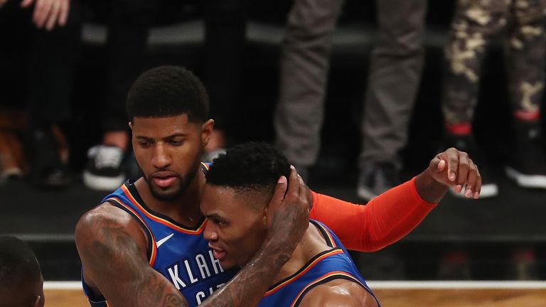 Paul George #13 of the Oklahoma City Thunder celebrates the winning three point shot with Russell Westbrook #0 in the final seconds of the game defeating the Brooklyn Nets 114-112 during their game at the Barclays Center on December 5, 2018 in New York City.