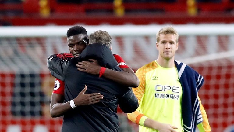 Manchester United's Paul Pogba and interim manager Ole Gunnar Solskjaer after the Premier League match vs Huddersfield Town at Old Trafford, Manchester
