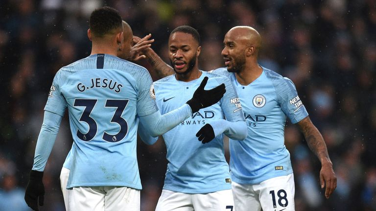 Raheem Sterling celebrates with team-mates after scoring from the bench