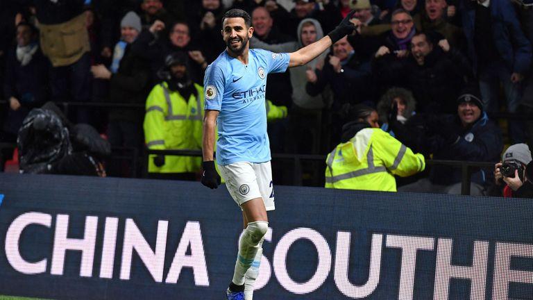 Riyad Mahrez celebrates after scoring Manchester City's second goal