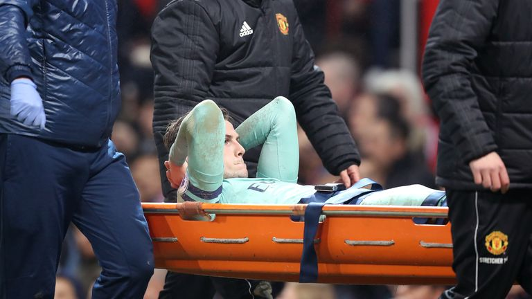 Rob Holding is stretchered off at Old Trafford