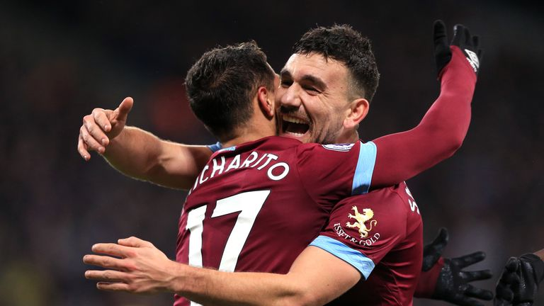 Robert Snodgrass and Javier Hernandez celebrate West Ham's second goal