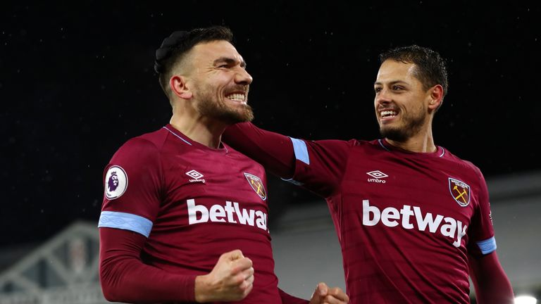 Robert Snodgrass celebrates his goal with Javier Hernandez