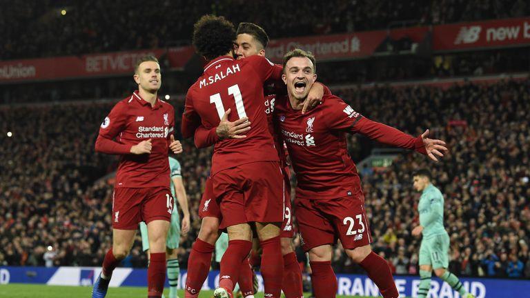 Roberto Firmino celebrates his third goal with Mohamed Salah and Xherdan Shaqiri