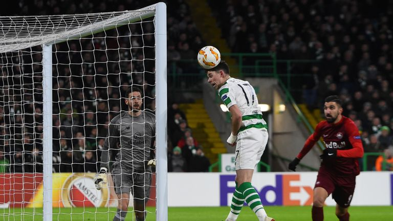 Ryan Christie heads clear after Salzburg hit the woodwork in the first half