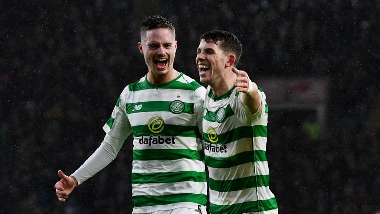 Ryan Christie celebrates his goal for Celtic to make it 4-0 with Mikael Lustig