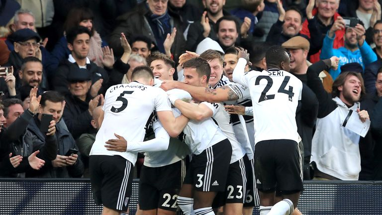Ryan Sessegnon is mobbed by team-mates after Fulham take the lead