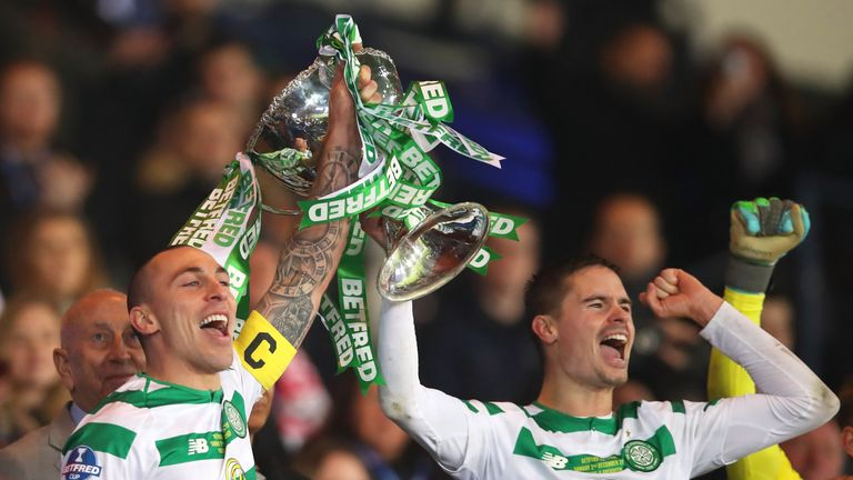 Scott Brown and Mikael Lustig lift the Scottish League Cup after Celtic's 1-0 win over Aberdeen