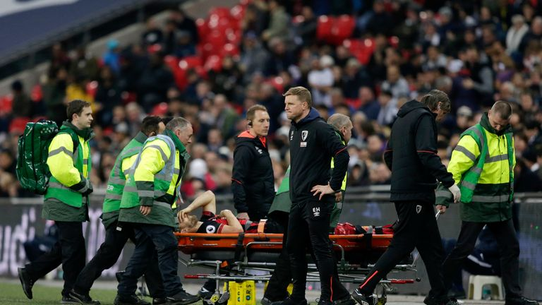 Simon Francis is stretchered off with a knee injury