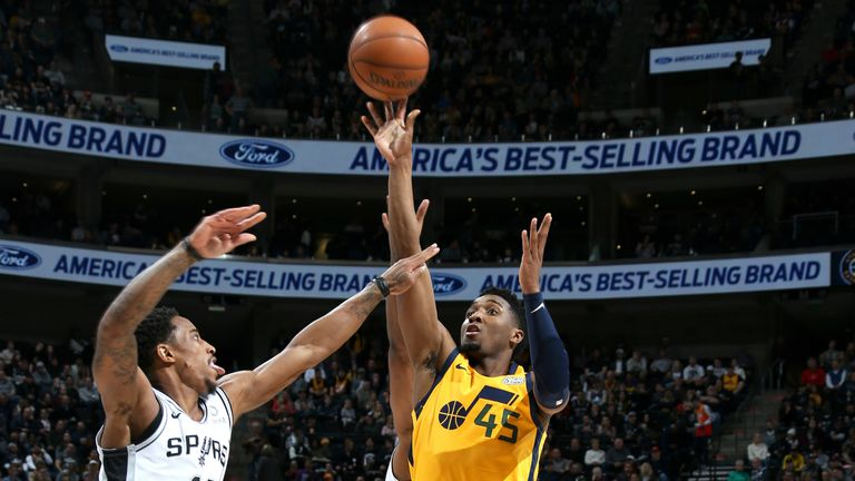Donovan Mitchell #45 of the Utah Jazz shoots the ball against the San Antonio Spurs on December 4, 2018 at vivint.SmartHome Arena in Salt Lake City, Utah.