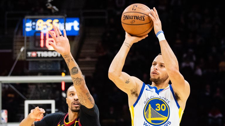 George Hill #3 of the Cleveland Cavaliers tries to block Stephen Curry #30 of the Golden State Warriors during the first half at Quicken Loans Arena on December 5, 2018 in Cleveland, Ohio