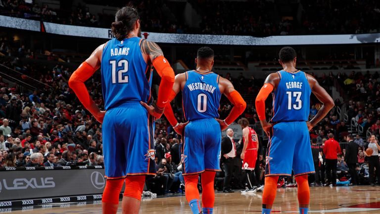 Steven Adams, Russell Westbrook and Paul George of the Oklahoma City Thunder look on during the game against the Chicago Bulls