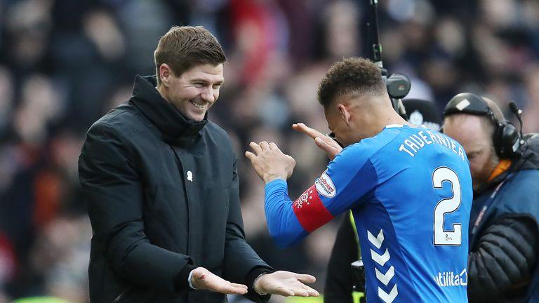 Steven Gerrard and James Tavernier celebrate Rangers' victory over Celtic