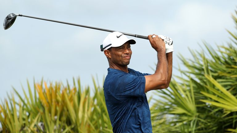 Tiger Woods props up the field on two under par