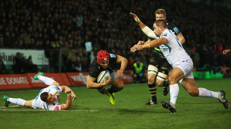 Tom Collins of Northampton Saints dives at the try line