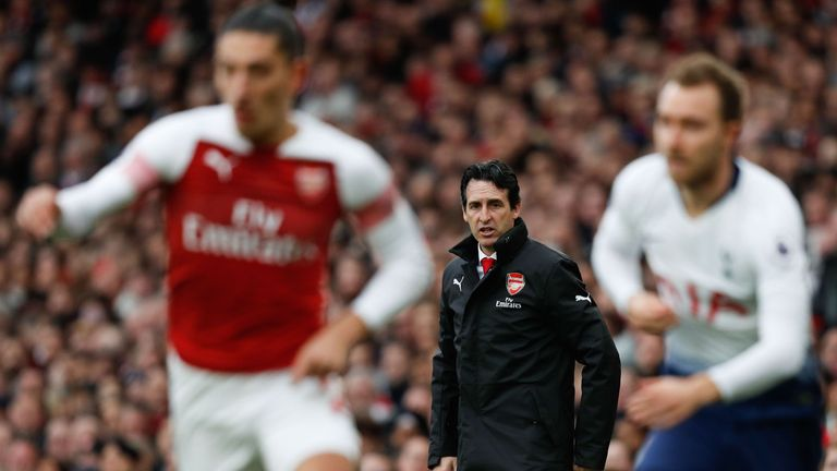 Unai Emery looks on from the touchline