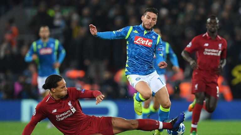 Liverpool's Dutch defender Virgil van Dijk fould Napoli's Belgian striker Dries Mertens during the UEFA Champions League group C football match between Liverpool and Napoli at Anfield stadium in Liverpool