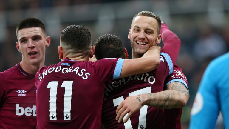 Javier Hernandez of West Ham United celebrates with teammates after scoring his team's second goal against Newcastle