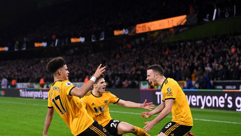 Morgan Gibbs-White, Ruben Vinagre and Diogo Jota celebrate as Wolves beat Chelsea 2-1