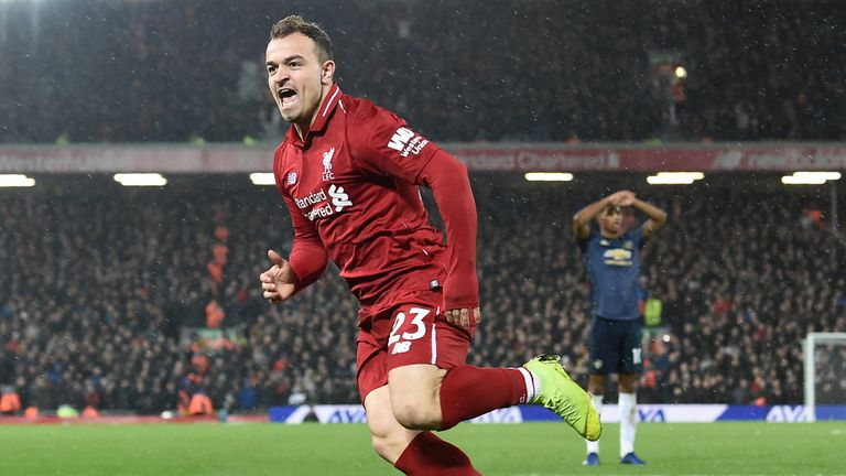 Xherdan Shaqiri celebrates after scoring Liverpool's second goal against Manchester United