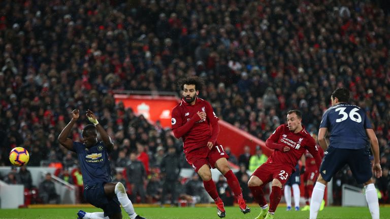 Xherdan Shaqiri scores Liverpool's third goal at Anfield