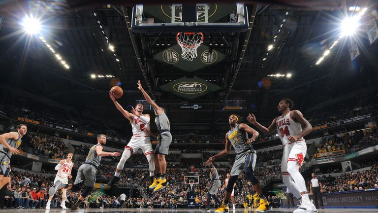 Zach LaVine #8 of the Chicago Bulls shoots the ball against the Indiana Pacers on December 4, 2018 at Bankers Life Fieldhouse in Indianapolis, Indiana.