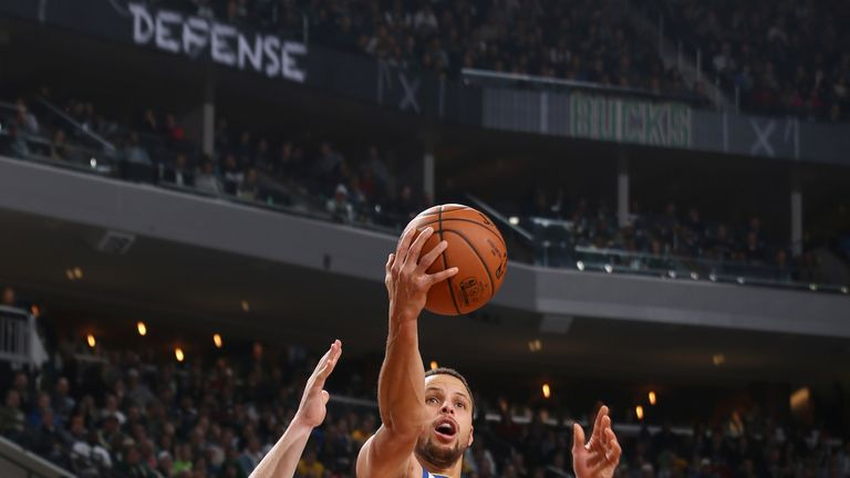 Stephen Curry rises to score against the Milwaukee Bucks