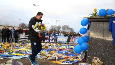 Cardiff chief executive Ken Choo laid flowers outside Cardiff City Stadium on Friday