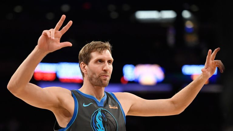 Dirk Nowitzki salutes the MSG crowd after making a three