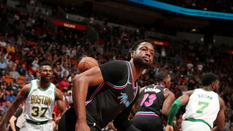 Dwyane Wade looks to the stands after scoring against Boston