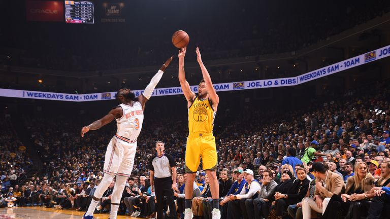 Klay Thompson fires a jump shot over Tim Hardaway Jr