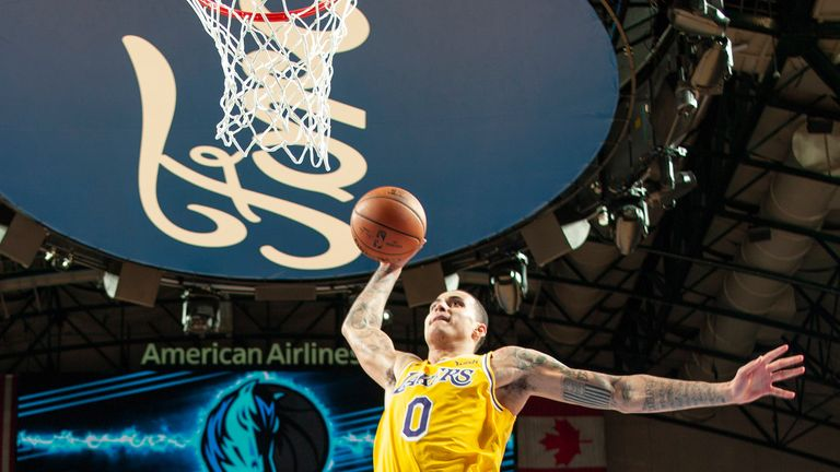 Kyle Kuzma soars for a dunk against Dallas