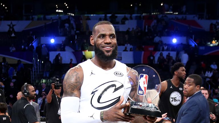 LeBron James poses with his MVP award at the 2108 All-Star game