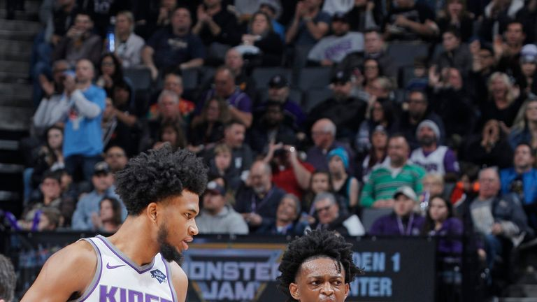 Sacramento Kings young guns Marving Bagley III and De'Aaron Fox exchange views on the court