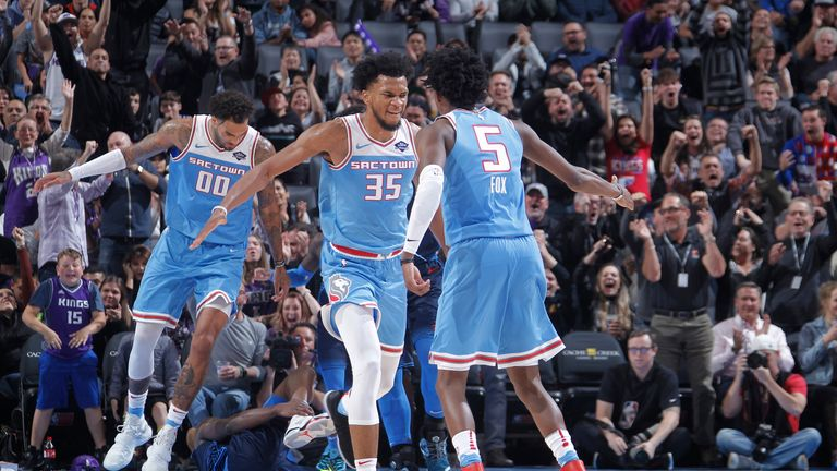 Young stars Marvin Bagley III and De'Aaron Fox celebrate a basket for the Sacramento Kings