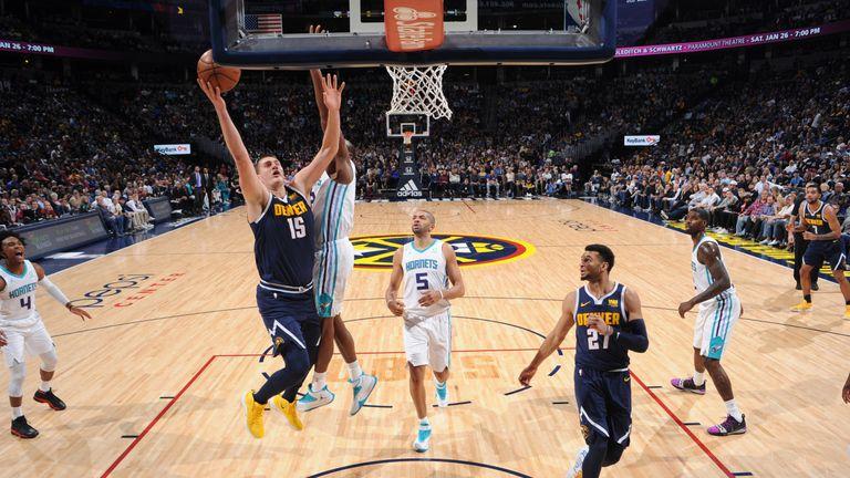 Nikola Jokic attacks the basket against Charlotte