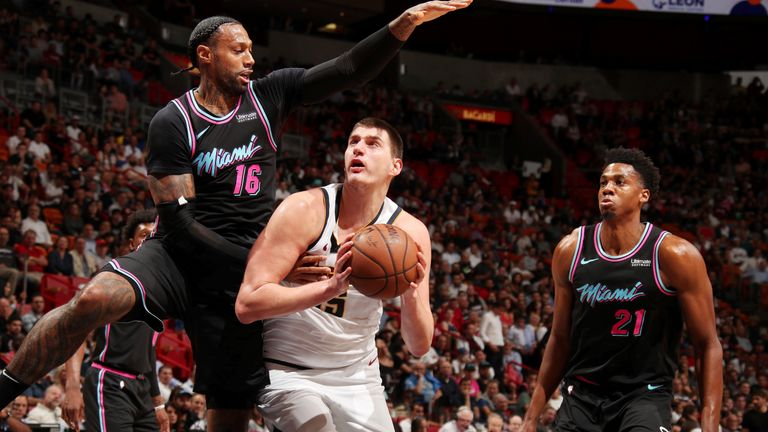 Nikola Jokic battles on the inside against the Miami Heat
